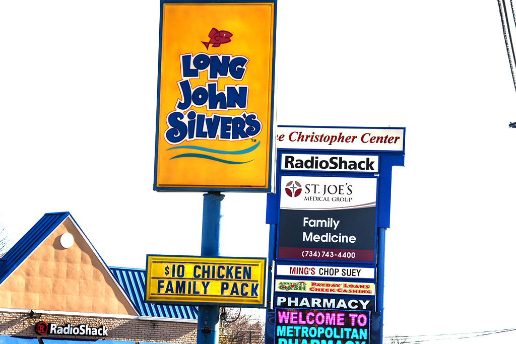 Strip mall signs on Plymouth--Redford