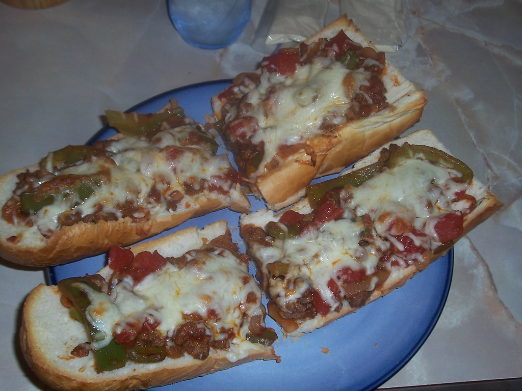 Pizza with Sausage, Peppers and Onion