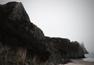 Image of Pobbles Beach near Southgate. ocean uk sea england cloud sun beach water fog wales coast mar seaside interestingness spring sand britain dunes united kingdom cliffs explore dorset future present claudia gower gabriela peninsula marques wimborne vieira milllane threecliffs threecliffsbay unit10 nicholaston futurepresent claudiavieira claudiagabrielamarquesvieira paisgales coastgen uniti0