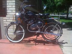 chopper(0.0), cruiser(0.0), bicycle(0.0), automobile(1.0), moped(1.0), wheel(1.0), vehicle(1.0), motorcycle(1.0), land vehicle(1.0),