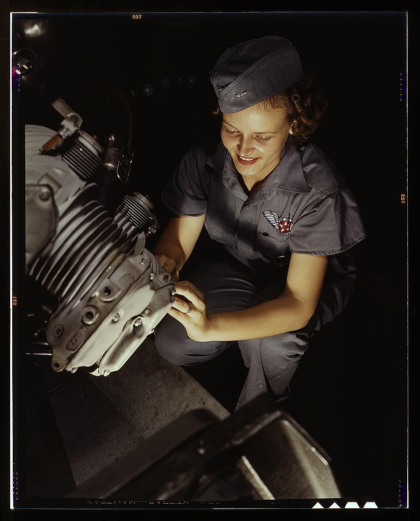 Assembly and Repairs Dept. mechanic Mary Josephine Farley works on a Wright Whirlwind motor, Naval Air Base, Corpus Christi, Texas (LOC)