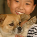 Chinese Girl and Her Dog - Xishuangbanna, China