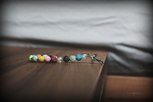 A rosary by the bedside by Arul Irudayam