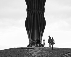 The Angel of the North is a contemporary sculpture, designed by Antony Gormley, which is located in Gateshead, Tyne and Wear, England. It is a steel sculpture of an angel, 20 metres tall, with wings measuring 54 metres across. The wings do not stand straight sideways, but are angled 3.5 degrees forw...