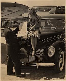 Joan Valerie Seated on Automobile, Lambert Airfield (MSA)