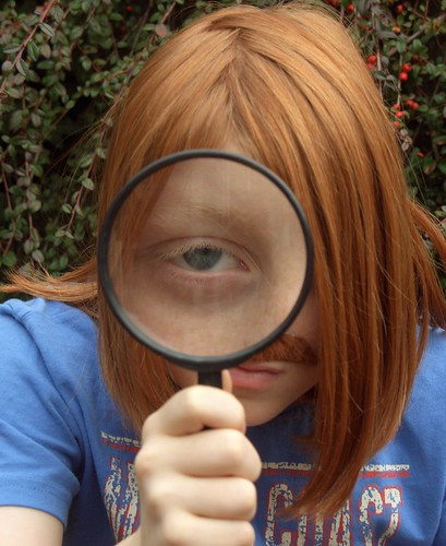 Red-headed kid with a magnifying glass