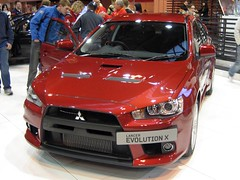 sports car(0.0), automobile(1.0), automotive exterior(1.0), wheel(1.0), vehicle(1.0), automotive design(1.0), mitsubishi(1.0), bumper(1.0), mitsubishi lancer evolution(1.0), sedan(1.0), land vehicle(1.0), supercar(1.0),