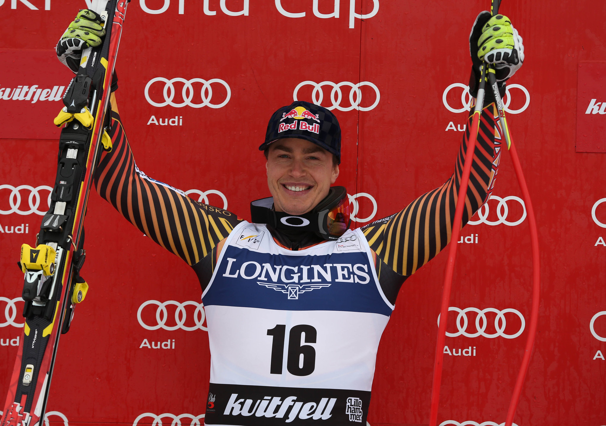 Erik Guay celebrates atop the podium in Kvitfjell, NOR