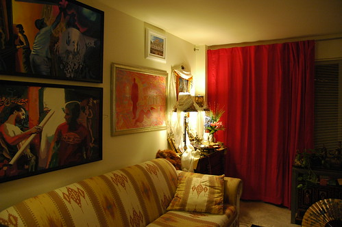 My old apartment living room, paintings, Buddhist shrine, lamps, red curtains, gold fan, southwest style fabric sofa, stuffed red ape Dezhung Rinpoche gave me when he was a little kid, Seattle, Washington, USA by Wonderlane