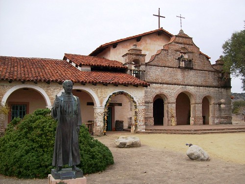 Mission San Antonio de Padua, chapel entrance and statue of Father Junipero Serra in remote Monterey County, CA - sanantonio004x