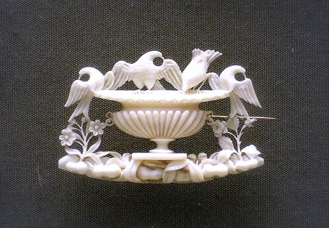 Carved ivory brooch