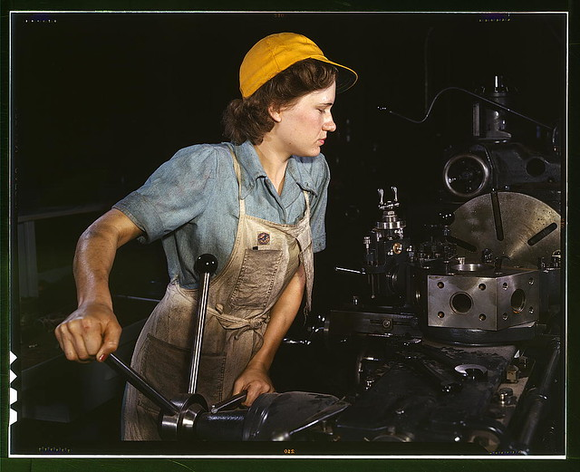 Lathe operator machining parts for transport planes at the Consolidated Aircraft Corporation plant, Fort Worth, Texas  (LOC)