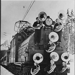 Members of Franklin High School band with train, Snoqualmie Pass