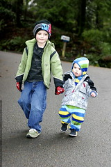 nick, holding hands and showing his little brother h…