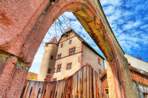 wood france tree castle stone clouds fence nikon gate arch village perspective wideangle explore alsace 12mm nikkor chateau schloss château hdr oldbuilding walbach d300 redstone historicbuilding woodendoor photomatix aplusphoto photofaceoffwinner pfogold