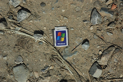 Microsoft Windows matchbox on the ground in rural Nepal. Found object. by Wonderlane