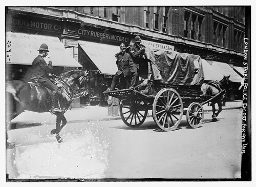 London Strike. Police escort for one van.  (LOC)