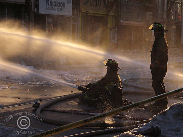 Firemen battling  Queen Street West Toronto Fire