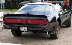 convertible(0.0), automobile(1.0), automotive exterior(1.0), vehicle(1.0), performance car(1.0), pontiac firebird(1.0), land vehicle(1.0), muscle car(1.0), sports car(1.0),