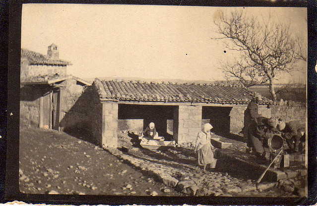 (Greek?) peasants filling cans in a farmyard 1915