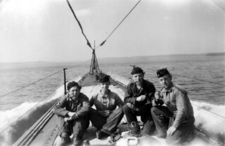 Submarine sailors on deck smoking pipe