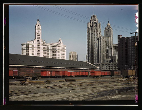 Trucks unloading at the inbound freight house of the Illinois Central Railroad, South Water Street freight terminal, Chicago, Ill. (LOC)