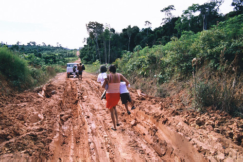 Walking on a mud-filled road in the Amazon