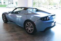 lotus(0.0), lotus evora(0.0), lotus elise(0.0), automobile(1.0), automotive exterior(1.0), tesla roadster(1.0), vehicle(1.0), automotive design(1.0), land vehicle(1.0), supercar(1.0), sports car(1.0),
