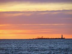 sun setting on lighthouse