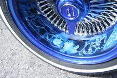 automotive exterior(0.0), automotive lighting(0.0), grille(0.0), bumper(0.0), headlamp(0.0), aircraft engine(0.0), tire(1.0), automotive tire(1.0), wheel(1.0), rim(1.0), alloy wheel(1.0), hubcap(1.0), spoke(1.0),