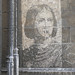 Image of Jeanne d'Arc on a stone wall in Rouen by Monceau