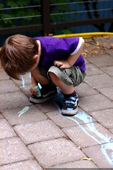 coloring his shoes with blue chalk    MG 4696