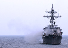 In this file photo, USS Howard (DDG 83) fires its 5-inch gun during a live-fire drone exercise (DRONEX) in the South China Sea as part of they Malaysia phase of exercise Cooperation Afloat Readiness and Training (CARAT) in June, 2011. (U.S. Navy photo by Mass Communication Specialist 3rd Class Brian A. Stone)