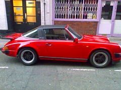 porsche 912(0.0), automobile(1.0), automotive exterior(1.0), ruf ctr(1.0), wheel(1.0), vehicle(1.0), porsche 911(1.0), porsche 911 classic(1.0), porsche 930(1.0), land vehicle(1.0), coupã©(1.0), convertible(1.0), sports car(1.0),