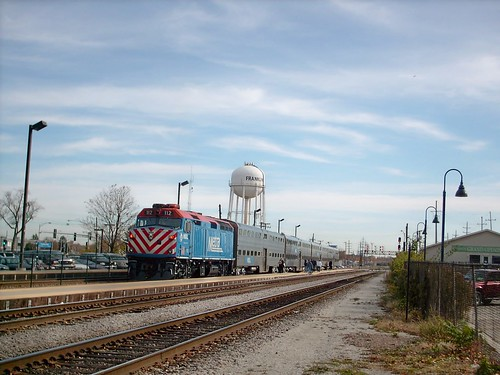 An eastbound Metra commuter local slows down for the station stop in Franklin Park Illinois. October 2007. by Eddie from Chicago