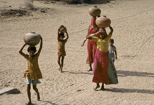Women and children carry water