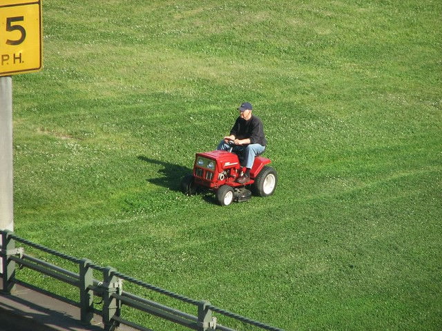 man on a riding lawnmower