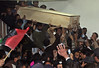 Supporters carry Bhutto's coffin from the hospital by Wonkette