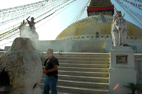 Saying farewell to a friend, sur smoke, making offerings at the wish fulfilling stupa in honor of the death of a friend, statues, prayer flags, white elephants, white wash, Boudha, Kathmandu, Nepal by Wonderlane