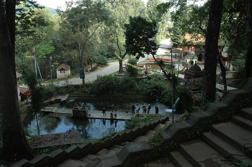 Pond and tanks, wallway, people, landscape near Yangleshö cave, Padmasambhava's realization and meditation, illumination location, Pharping, Nepal by Wonderlane