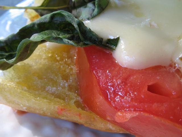 Basil, brie, bread, tomato sandwich