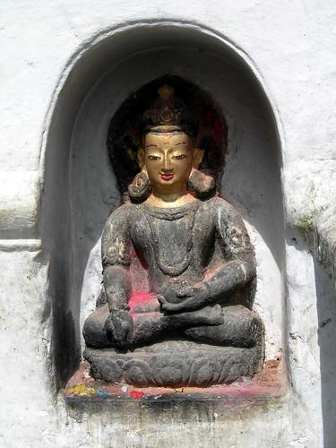 Buddha statue in a nitche, at Swayambhunath, Kathmandu, Nepal by Wonderlane