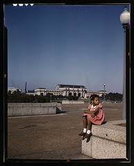 Little girl in a park with Union Station in the background, Washington, D.C.  (LOC)