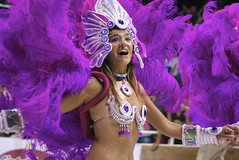 sports(0.0), quinceaã±era(0.0), festival(1.0), carnival(1.0), purple(1.0), event(1.0), samba(1.0), performing arts(1.0), entertainment(1.0), dance(1.0),