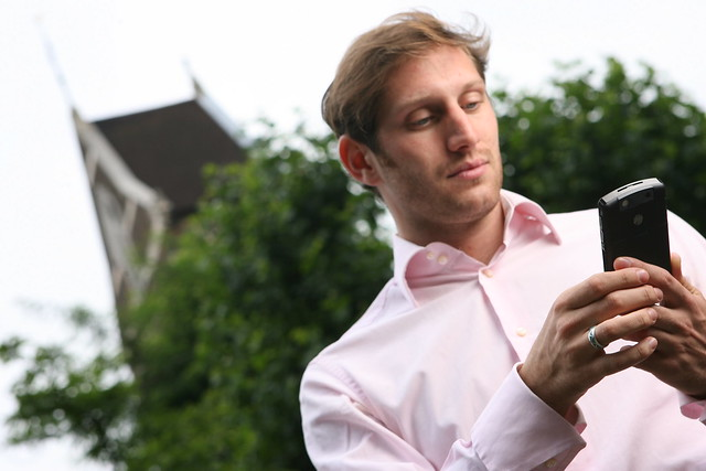 Man using Windows Mobile device keypad outside