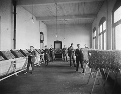 Students grading hay, 1920
