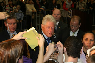 Bill Clinton signs autographs