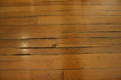 wall(0.0), floor(1.0), plywood(1.0), plank(1.0), wood(1.0), wood stain(1.0), laminate flooring(1.0), wood flooring(1.0), lumber(1.0), hardwood(1.0), flooring(1.0),