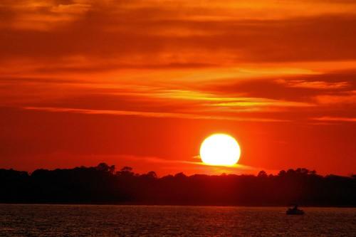 sunset orange sun boat muted ponceinlet