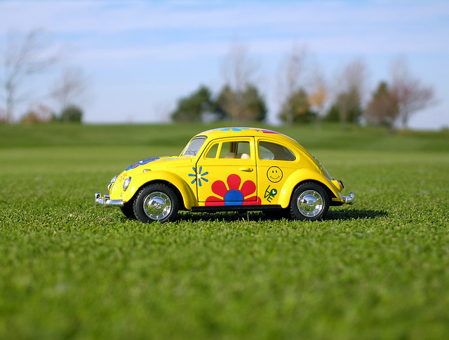a yellow volkswagen beetle in the grass flickr photo sharing. Black Bedroom Furniture Sets. Home Design Ideas